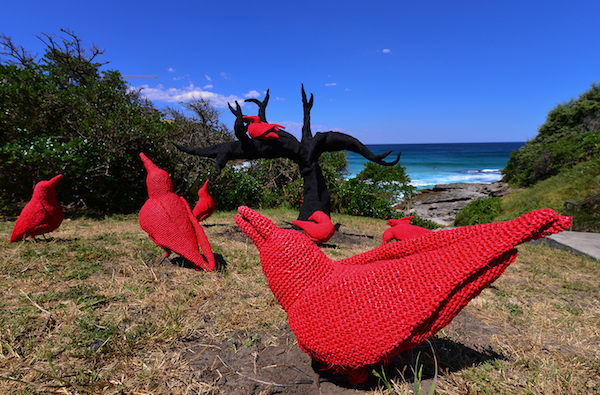 Mikaela Castledine, east of the mulberry tree- the legend of the ten red crows, Sculpture by the Sea, Bondi 2013. Photo Clyde Yee