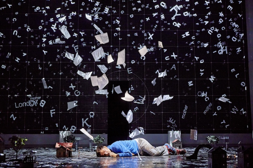 Man lying on the floor as paper rains down on him