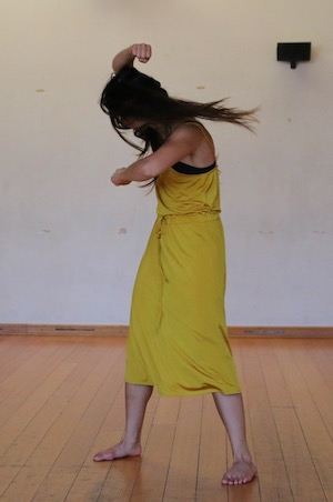 Girl dancing in yellow playsuit