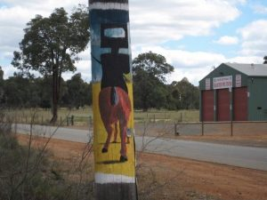 Ned Kelly on a telegraph post