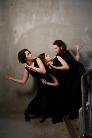 three girls in black dresses