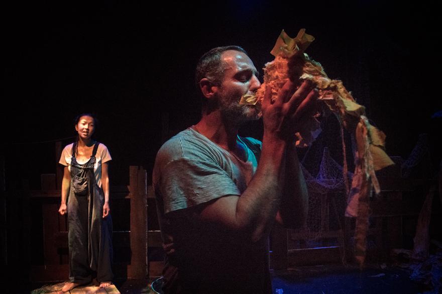 A man kissing a fish puppet