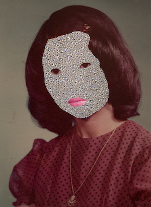 Woman whose face is obscured by a glittering mask