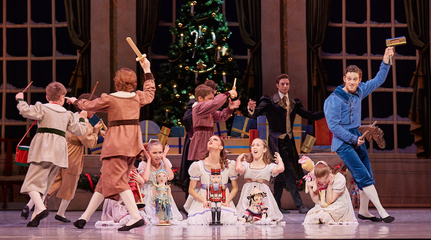 Carina Roberts as Clara and Matthew Edwardson as Fritz with Child Guest Artists in The Nutcracker. Photo by Sergey Pevnev