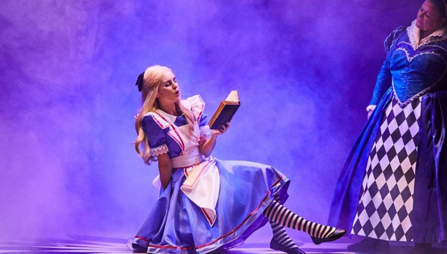 Alice reading a book and swinging her legs