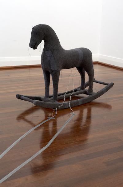 A sculpture of a rocking horse