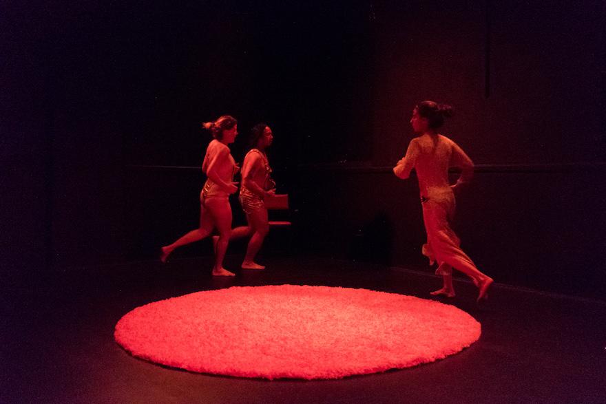 Julia Croft, Harriet Gillies and Joe Lui running around a red carpet.