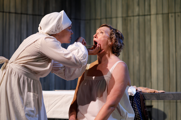 A scene from 'Water'. A nurse examines a patient's throat.