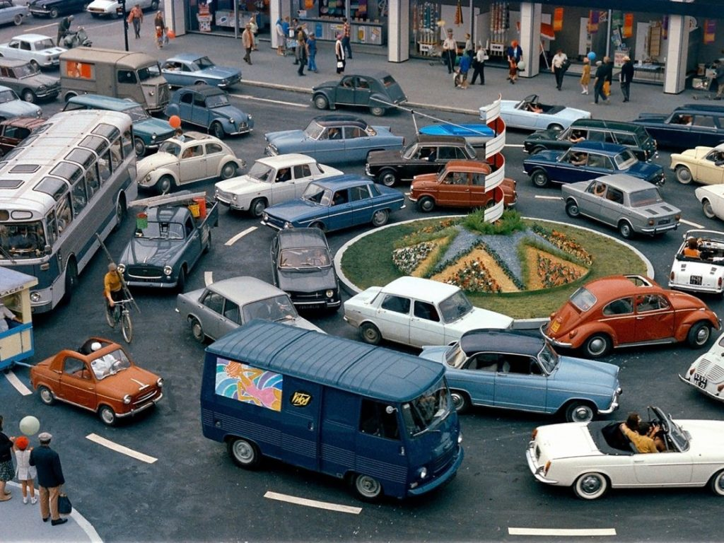 Vehicles crowd a roundabout in 1970's Paris