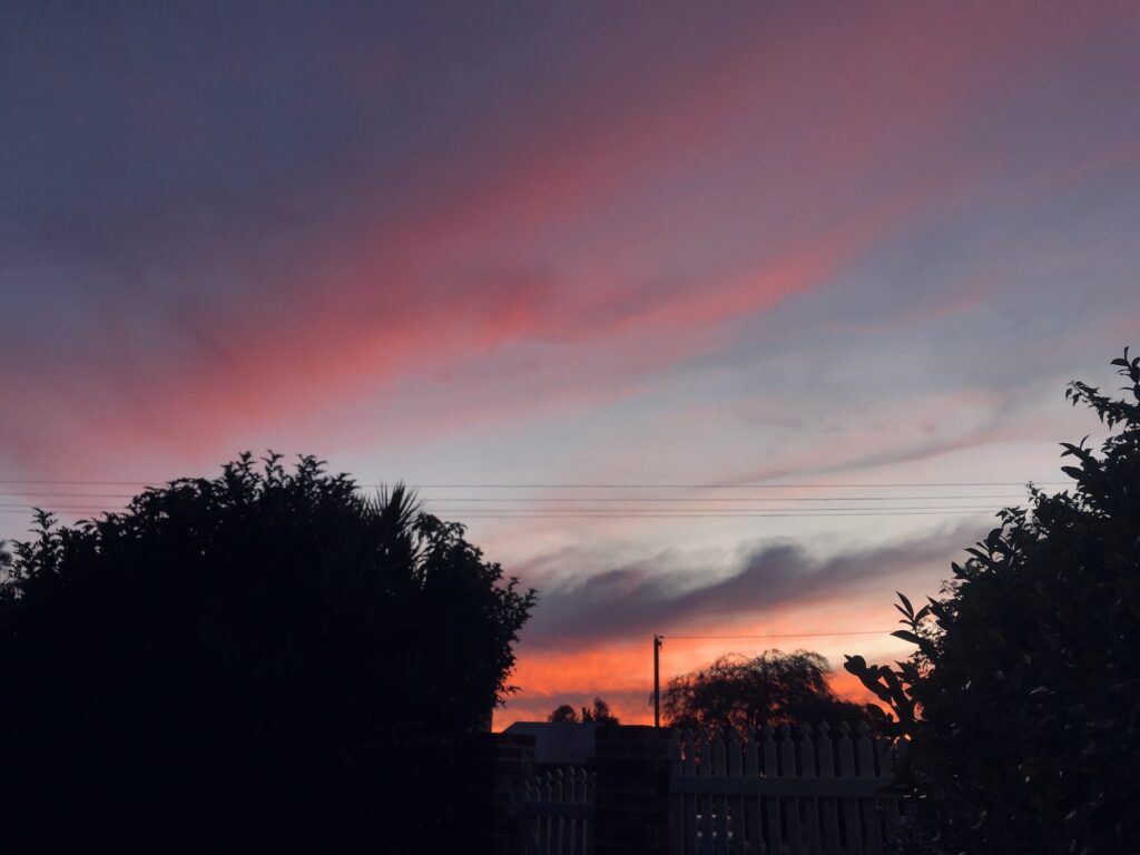 A sunset, with the sky streaked pink