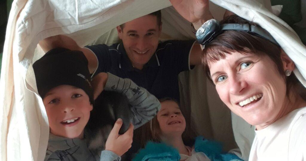 A family shelter under a sheet