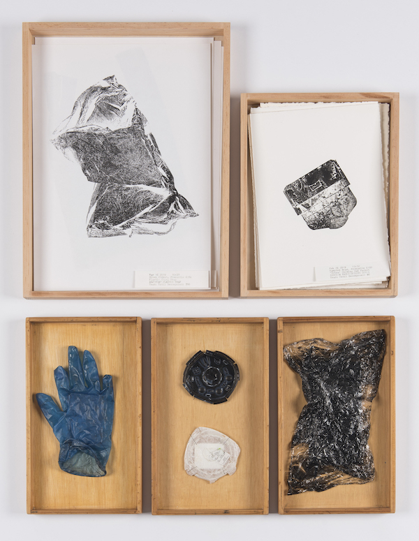 Pictured is Grace Crogan's 'A walk to school in 2019' features items of rubbish, such as a plastic glove, or a scrunched up plastic bag, and prints created from the rubbish, each carefully displayed in a wooden box.