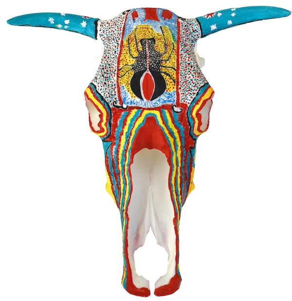 A brightly coloured 3D printed cow skull. It's horns are adorned with the Australian flag, and a redback spider adorns its head.