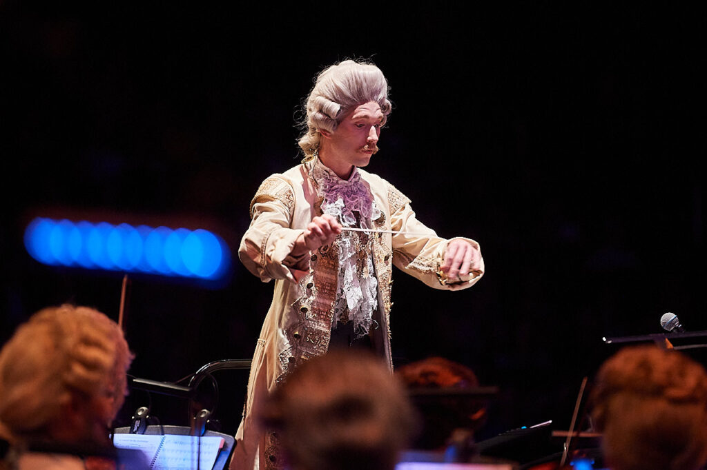 A conductor in 18th century costume