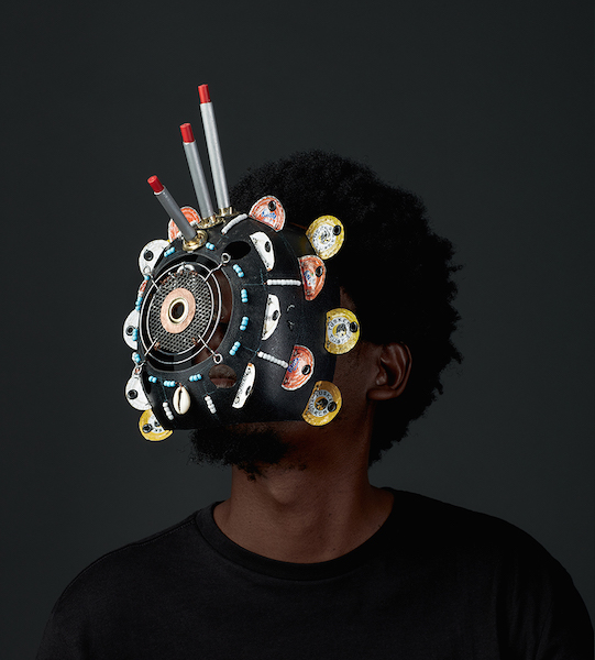 A person wearing a mask made of layers of discs.